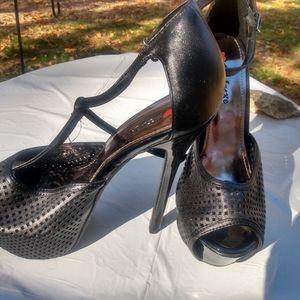 Black strappy sky-high heels.